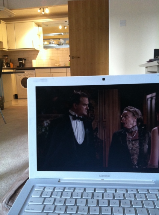 Washer-Dryer in the kitchen, me on the couch with Downton.