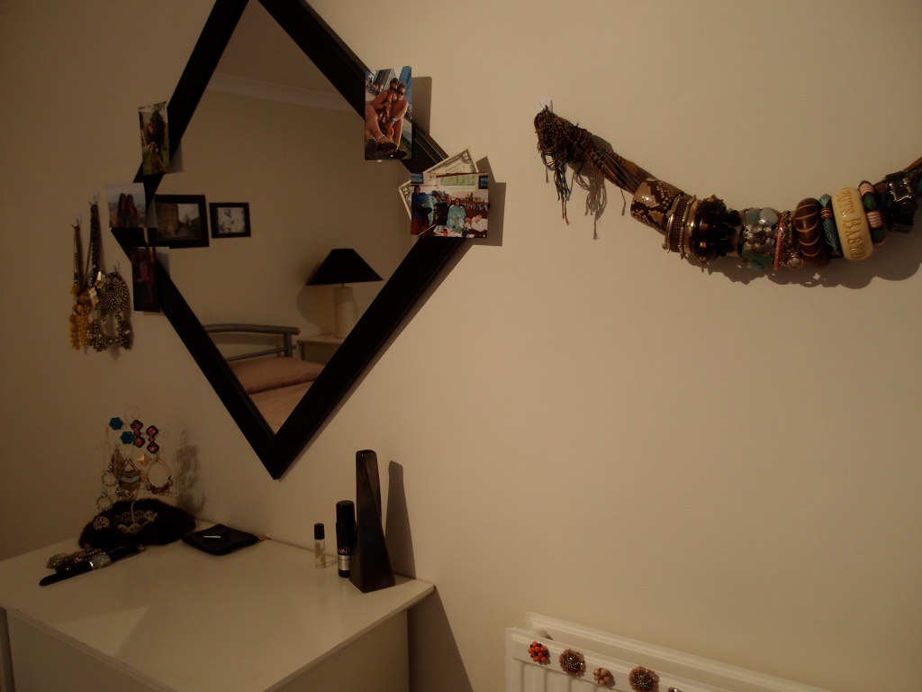 Another attempt to Sarify the space: Hung my bracelets on a scarf and my necklaces on the wall.