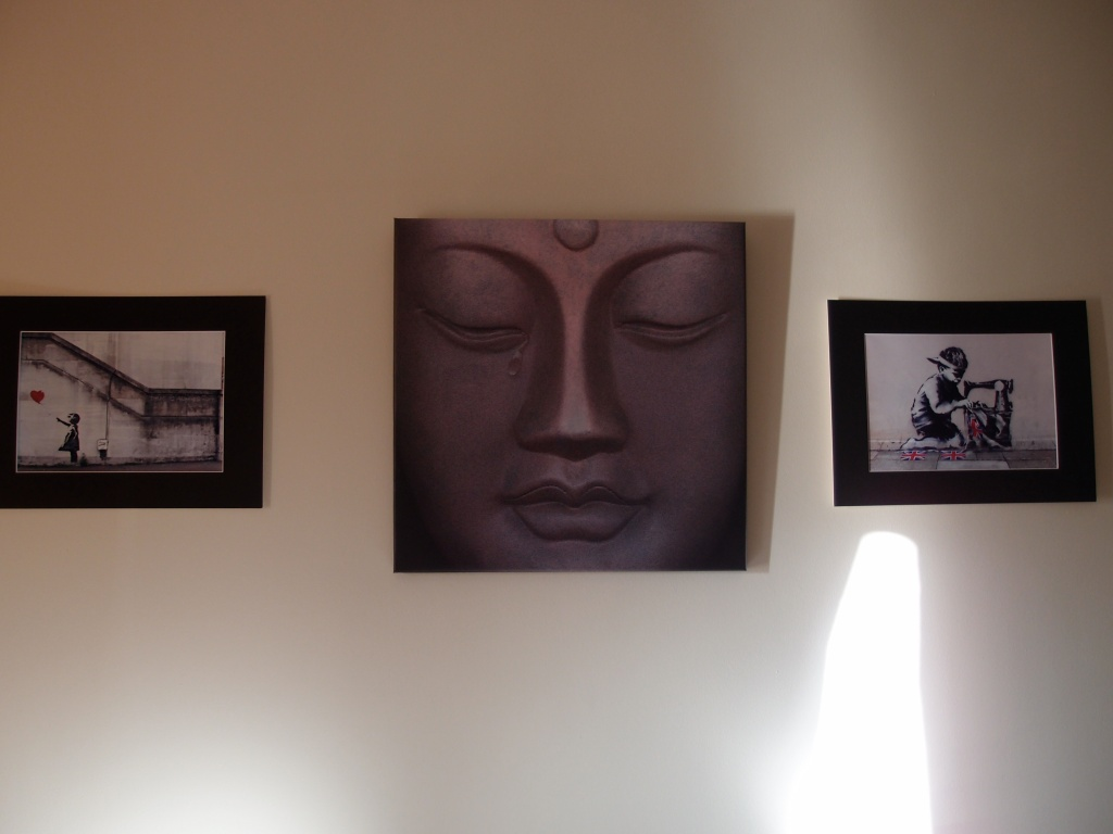Artsy Banksy and a Buddah.