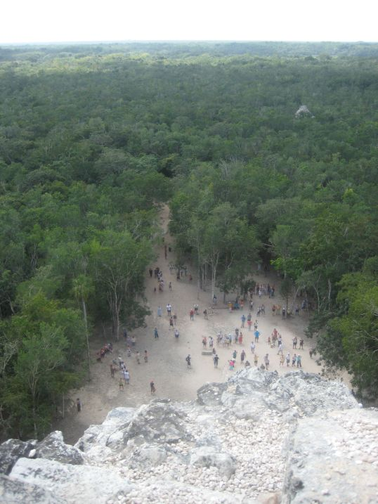 Little people at the bottom of Mayan Ruins in Tulum.