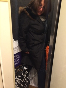 Mom attempting to get into the world's smallest elevator with our bags.