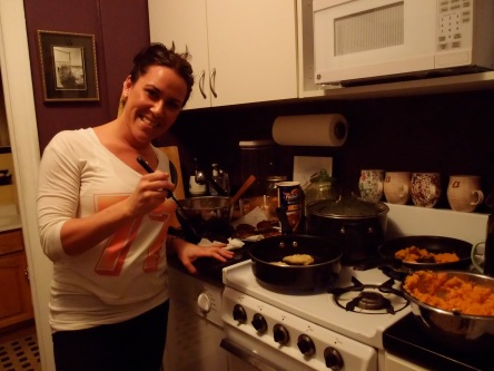Amy helping with the latkes