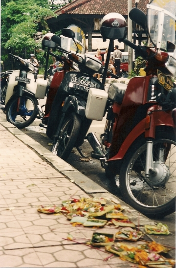 Motorbikes and morning flower offerings: the icons of Bali.