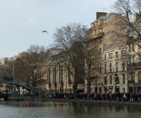 Crowds along its banks