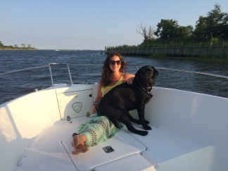 At the tip of the canal by the bay, sitting on the bow with Maggie Mae